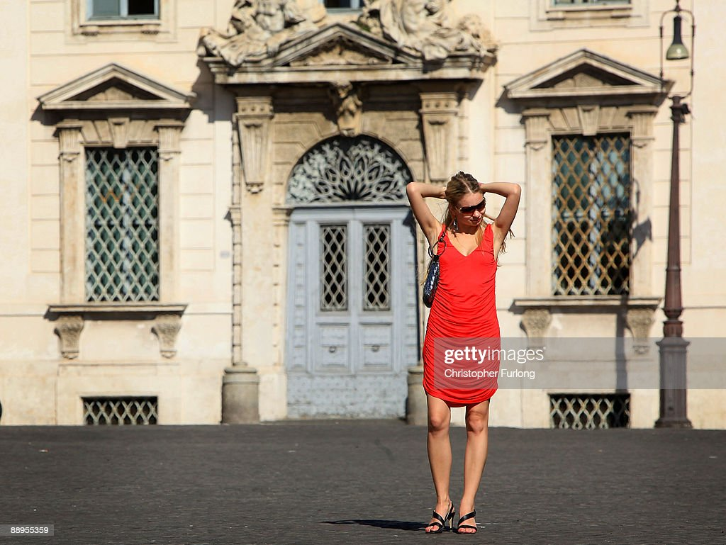 A woman adjust her hair in Palazzo Del Quirinale on July 9, 2009 in Rome, Italy. With nearly 3000 years of history Rome continues to live up to its motto of The Eternal City being one of the founding cities of Western Civilisation.