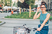 Girl smiling while cycling in the city