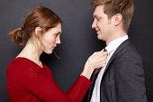 Woman adjusting her husband's tie