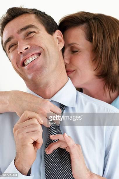Woman Adjusting Husbands Necktie