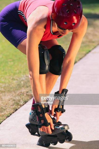 Woman Adjusting Inline Skates