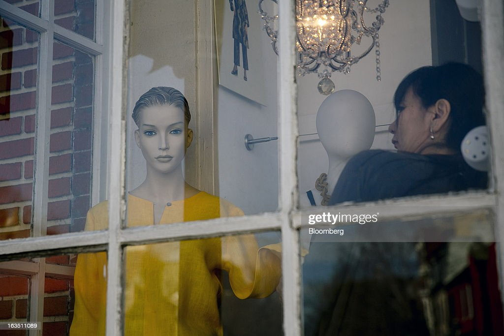 A woman adjusts a mannequin at a Helia's retail store in the Georgetown neighborhood of Washington, D.C., U.S., on Saturday, March 9, 2013. The U.S. Census Bureau is expected to release advance retail sales data for February on March 13. Photographer: Andrew Harrer/Bloomberg via Getty Images