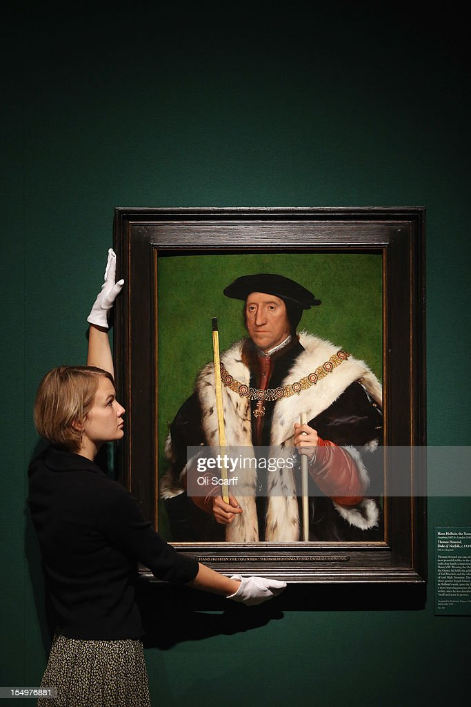 A woman adjusts a painting by Hans Holbein the Younger entitled 'Thomas Howard, Duke of Norfolk' in the exhibition 'The Northern Renaissance: Durer to Holbein' at The Queen's Gallery on October 29, 2012 in London, England. The exhibition, which celebrates the Renaissance in Northern Europe through work by some of the finest artists of the era, opens to the general public on November 2, 2012 and runs until April 14, 2013.