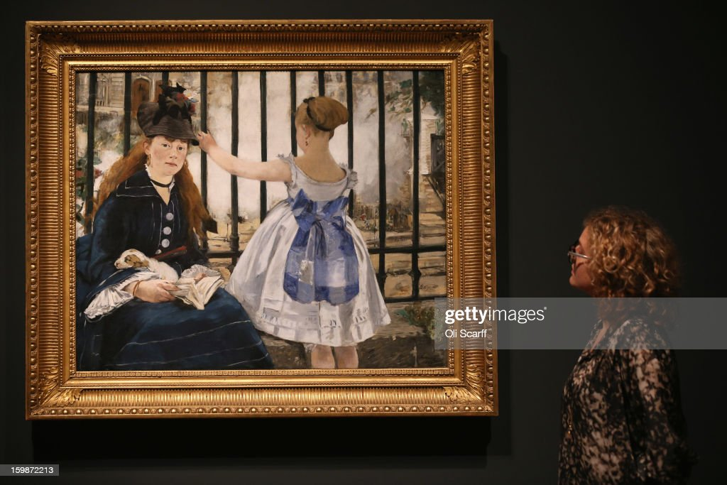 A woman admires a painting by Edouard Manet entitled 'The Railway' in the Royal Academy of Arts on January 22, 2013 in London, England. The painting features in the Royal Academy's new exhibition 'Manet: Portraying Life' which displays over 50 paintings spanning his career. The exhibition open to the general public on January 26, 2013 and runs until April 14, 2013.
