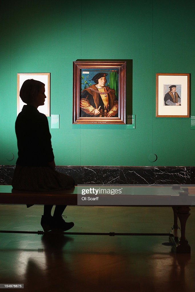 A woman admires a painting by Hans Holbein the Younger entitled 'Sir Henry Guildford' (C) in the exhibition 'The Northern Renaissance: Durer to Holbein' at The Queen's Gallery on October 29, 2012 in London, England. The exhibition, which celebrates the Renaissance in Northern Europe through work by some of the finest artists of the era, opens to the general public on November 2, 2012 and runs until April 14, 2013.