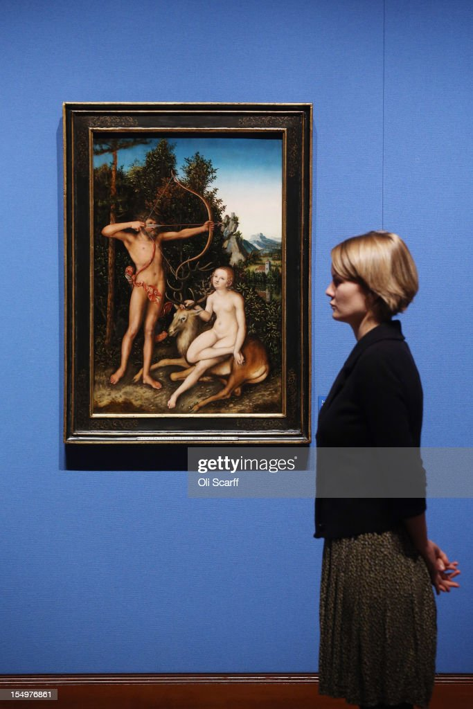 A woman admires a painting by Lucas Cranach the Elder entitled 'Apollo and Diana' in the exhibition 'The Northern Renaissance: Durer to Holbein' at The Queen's Gallery on October 29, 2012 in London, England. The exhibition, which celebrates the Renaissance in Northern Europe through work by some of the finest artists of the era, opens to the general public on November 2, 2012 and runs until April 14, 2013.