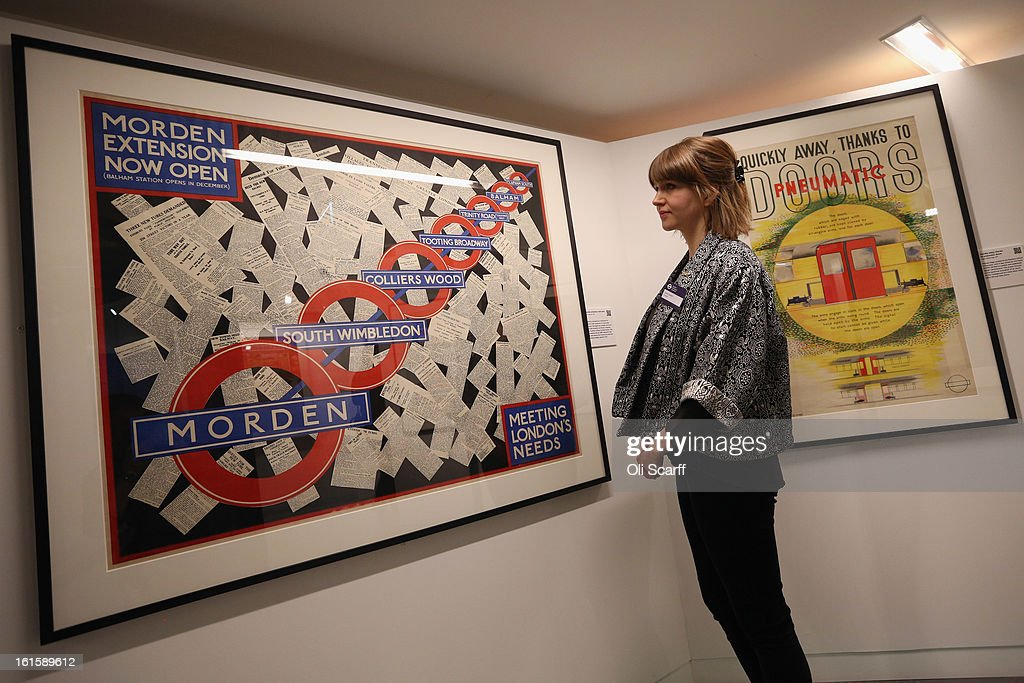 A woman admires a poster from 1926 entitled 'Morden extension now open' in the exhibition 'Poster Art 150 - London Underground's Greatest Designs' in the London Transport Museum on February 12, 2013 in London, England. The exhibition celebrates 150 years of the London Underground by showcasing 150 posters from the Museum's archive of over 3,300. The exhibition opens on February 15, 2013 and runs until October 27, 2013.