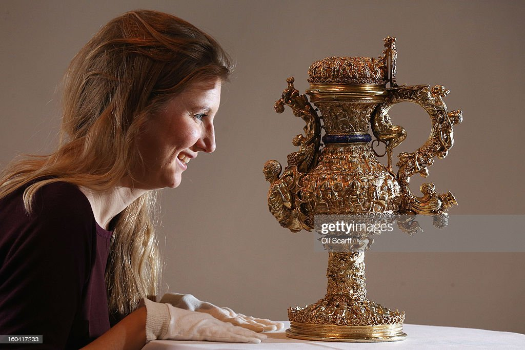 A woman admires a 'silver gilt ewer with enamelled royal arms of Portugal' that dates from around 1510 AD in the Institute of Contemporary Arts, prior to an announcement of a major bequest of silver artifacts to the Ashmolean Museum on January 31, 2013 in London, England. The Ashmolean has received a major collection of around 500 silver objects from the Renaissance and Baroque periods from the late silver merchant and expert Michael Wellby who died last year.