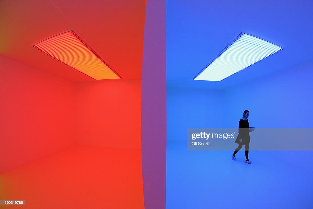 A woman admires an art installation by Carlos Cruz-Diez entitled 'Chromosaturation' which features in the Hayward Gallery's exhibition 'Light Show' on January 29, 2013 in London, England. 'Light Show' features 25 illuminated installations and sculptures by major international artists from the 1960s to the present day. The show opens to the general public on January 30, 2013 and runs until April 28, 2013.