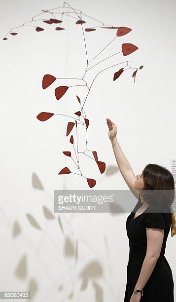 A woman admires an artwork entitled 'Sumac V' by US artist Alexander Calder at the Royal Academy of Arts in London on September 30 2008 The artwork...