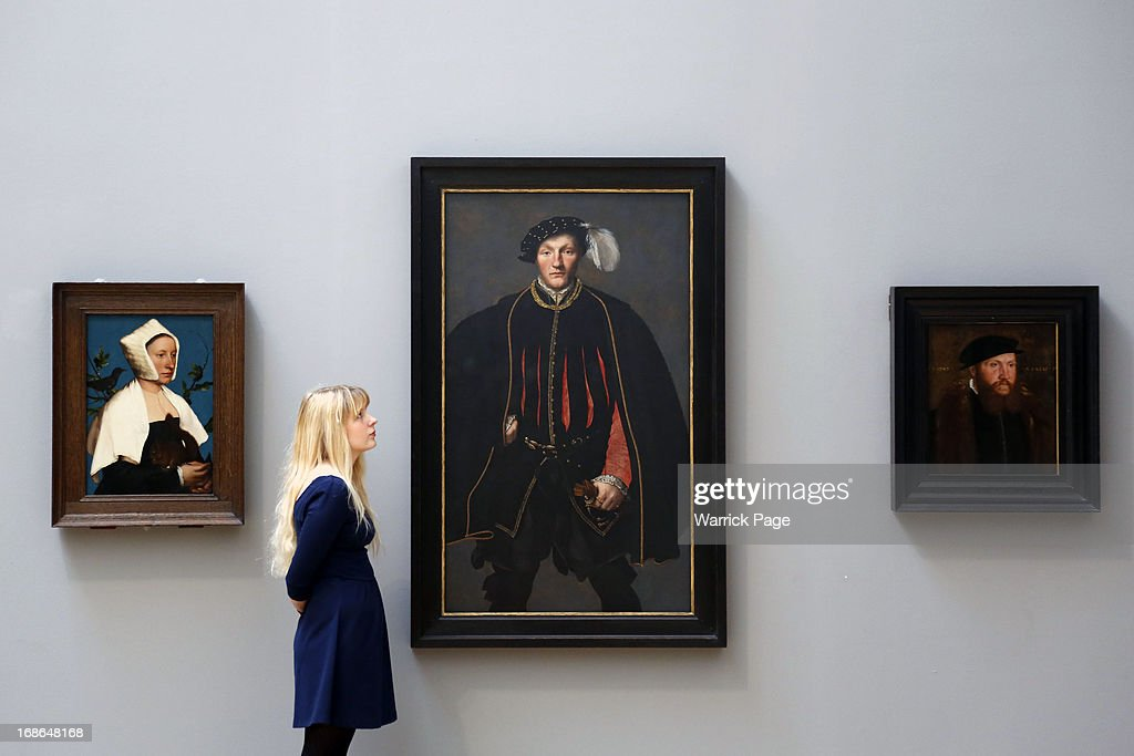 A woman admires artwork on display at the Walk through British Art at Tate Britain on May 13, 2013 in London, England. Visitors will experience a completely new presentation of the world's greatest collection of British art, the national collection of British art will be displayed in a continuous and purely chronological display from the 1500s to the present day.