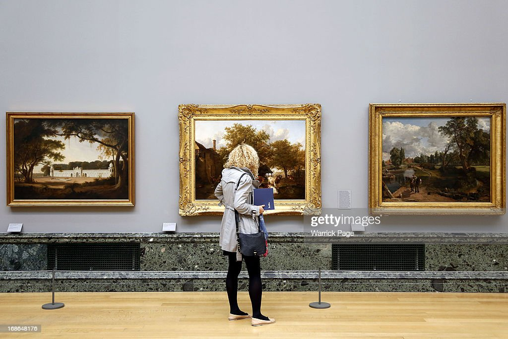 A woman admires artwork on display at the Walk through British Art exhibition at Tate Britain on May 13, 2013 in London, England. Visitors will experience a completely new presentation of the world's greatest collection of British art, the national collection of British art will be displayed in a continuous and purely chronological display from the 1500s to the present day.