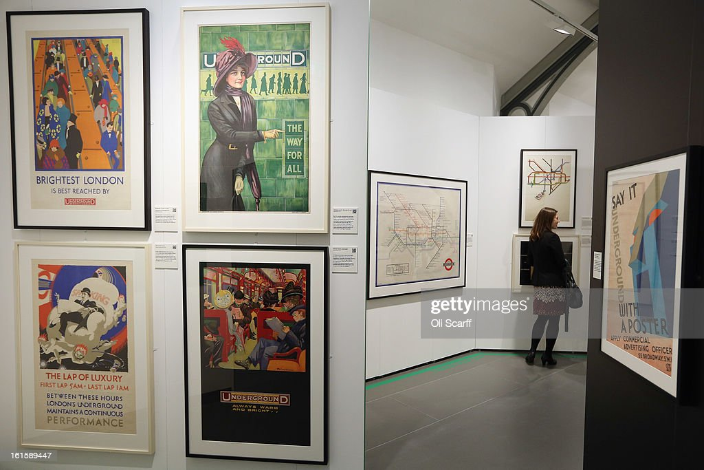 A woman admires posters on display in the exhibition 'Poster Art 150 - London Underground's Greatest Designs' in the London Transport Museum on February 12, 2013 in London, England. The exhibition celebrates 150 years of the London Underground by showcasing 150 posters from the Museum's archive of over 3,300. The exhibition opens on February 15, 2013 and runs until October 27, 2013.