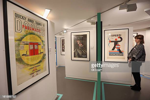 A woman admires posters on display in the exhibition 'Poster Art 150 London Underground's Greatest Designs' in the London Transport Museum on...