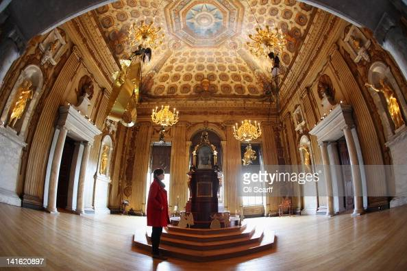 A woman admires the decor in The Cupola Room in Kensington Palace on March 20 2012 in London England Kensington Palace is due to reopen to the public...