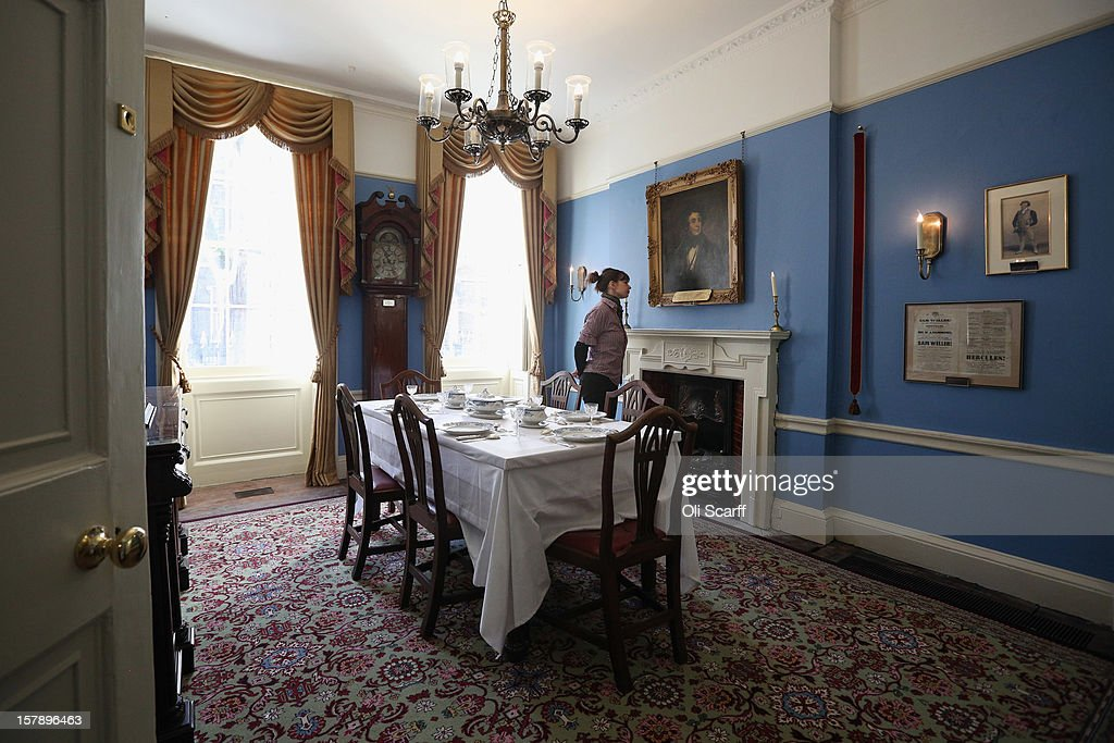 A woman admires the Dining Room inside the Charles Dickens Museum on December 7, 2012 in London, England. The museum will re-open to the public on December 10, 2012 following a major 3.1 million GBP refurbishment and expansion programme to celebrate Dickens' bicentenary year. The museum is located in Charles Dickens' house on Doughty Street where he lived from 1837 until 1839 and in which he wrote many novels including Oliver Twist and Nicholas Nickleby.