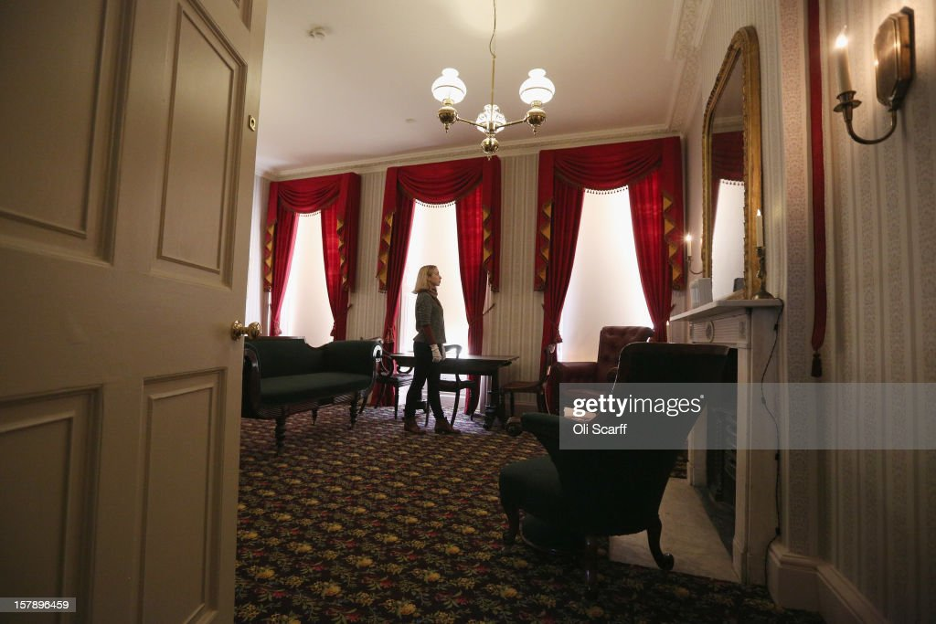 A woman admires the Drawing Room inside the Charles Dickens Museum on December 7, 2012 in London, England. The museum will re-open to the public on December 10, 2012 following a major 3.1 million GBP refurbishment and expansion programme to celebrate Dickens' bicentenary year. The museum is located in Charles Dickens' house on Doughty Street where he lived from 1837 until 1839 and in which he wrote many novels including Oliver Twist and Nicholas Nickleby.