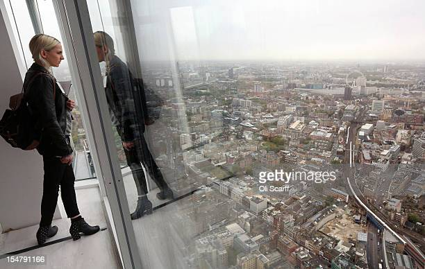 A woman admires the view from the 69th floor of The Shard skyscraper on the preview day to mark the sale of tickets for the 'View from The Shard'...