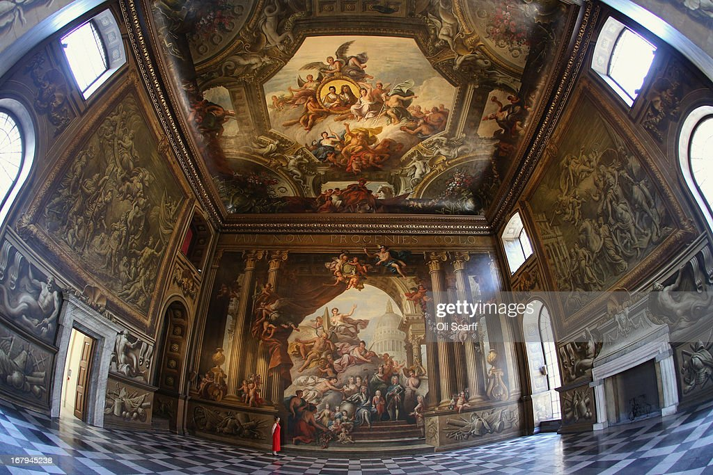 A woman admires the west wall of the The Old Royal Naval College's Painted Hall following its first restoration in 50 years on May 2, 2013 in Greenwich, England. The west wall and upper hall ceiling have undergone several months of intensive conservation work. Conservation of the entire Painted Hall is expected to cost in excess of 2.5 million GBP and take several years.
