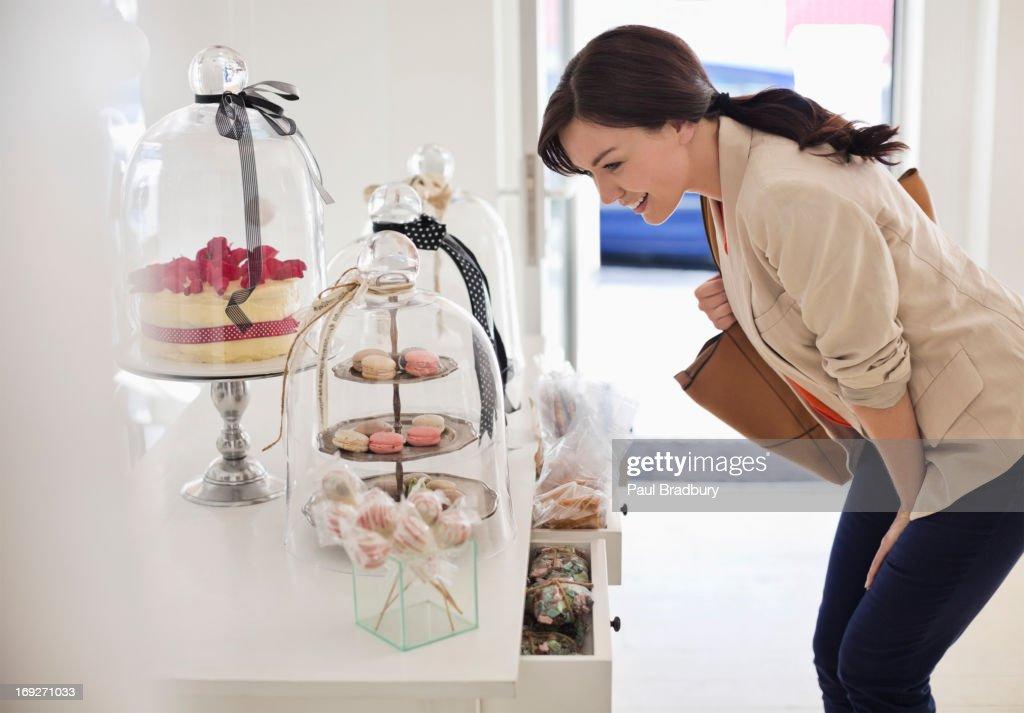 Woman admiring cookies in store