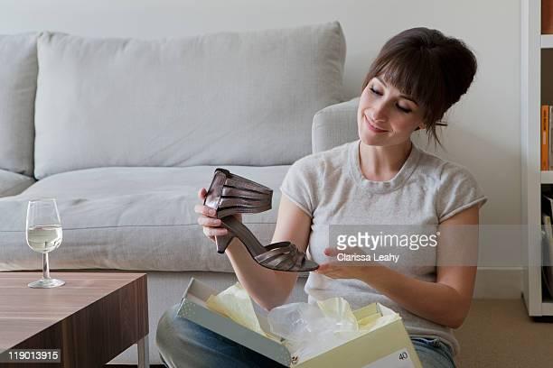 Woman admiring new shoe