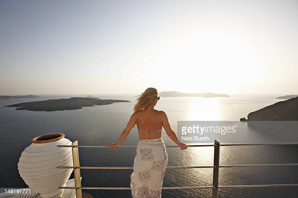 Woman admiring ocean view from balcony