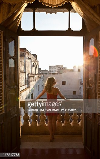 Woman admiring view from balcony : Foto de stock