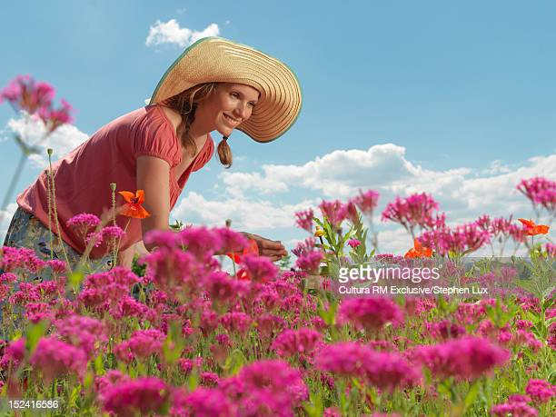Woman admiring wildflowers