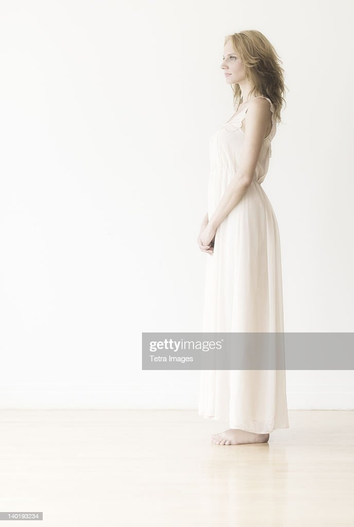 Woman against white background, studio shot