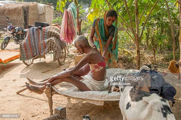 A woman aiding a sick man
