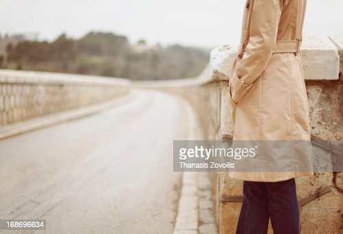 Woman alone waiting on a bridge