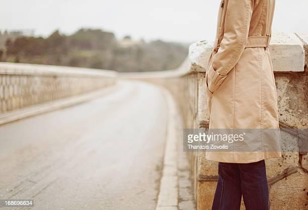 Woman alone waiting on a bridge