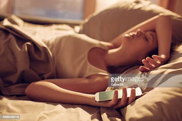 Woman alseep next to smart phone