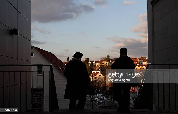 A woman and a boy walk through the city on March 4 2010 in Winnenden Germany Tim Kretschmer opened fire on teachers and pupils at the Albertville...