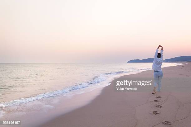 Woman and a Calm Beach in Dawn