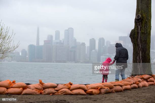 TORONTO ON MAY 5 A woman and a child walk along the shore of Wards Island Toronto Mayor John Tory visited the Wards Island to see the flooding...