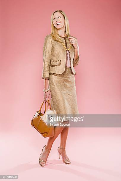 Woman and a dog in a handbag