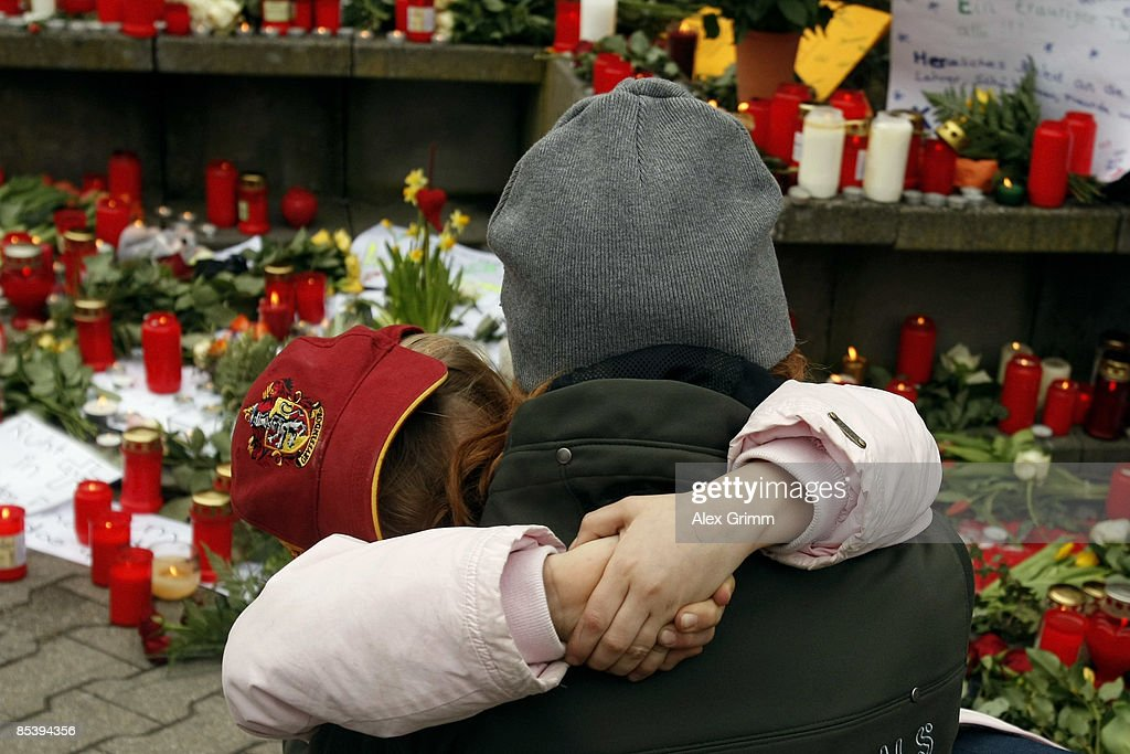 A woman and a girl mourn in front of the AlbertvilleSchool Centre on March 12 2009 in Winnenden near Stuttgart Germany 17 year old Tim Kretschmer...