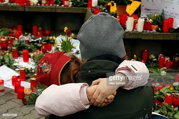A woman and a girl mourn in front of the AlbertvilleSchool Centre on March 12 2009 in Winnenden near Stuttgart Germany 17 year old Tim Kretschmer...