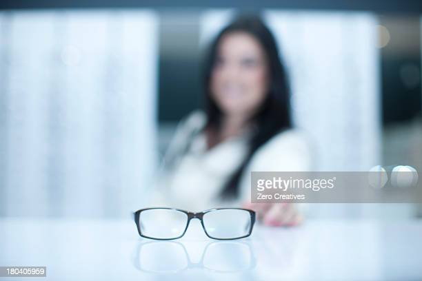 Woman and a pair of eyeglasses