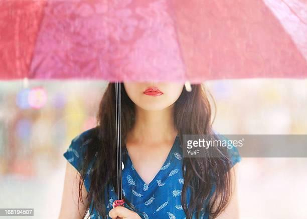 Woman and a pink umbrella.