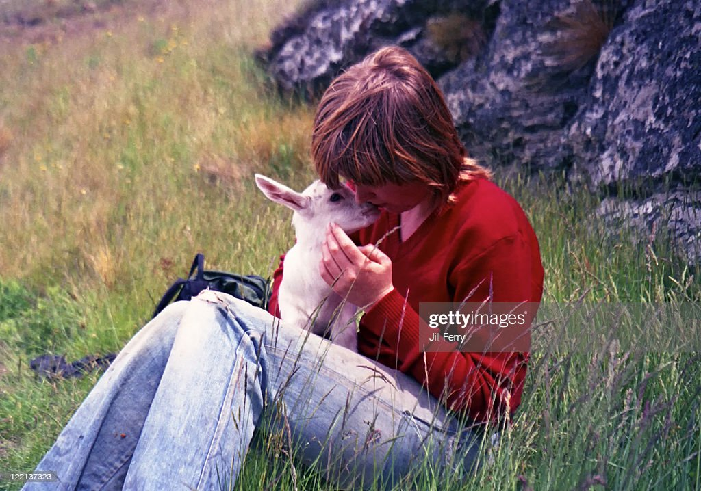 Woman and baby goat : Stock Photo