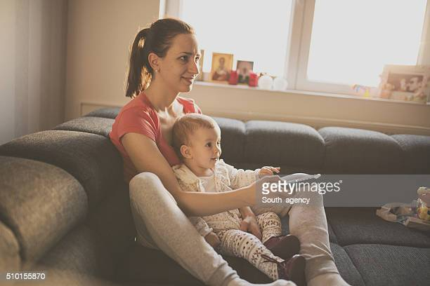 Woman and baby watching tv