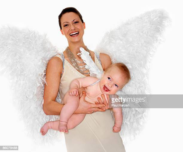 Woman and baby with angel wings