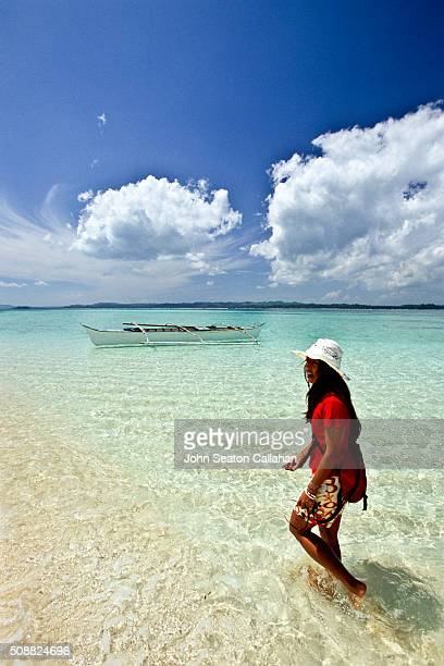 Woman and boat on Dako Island