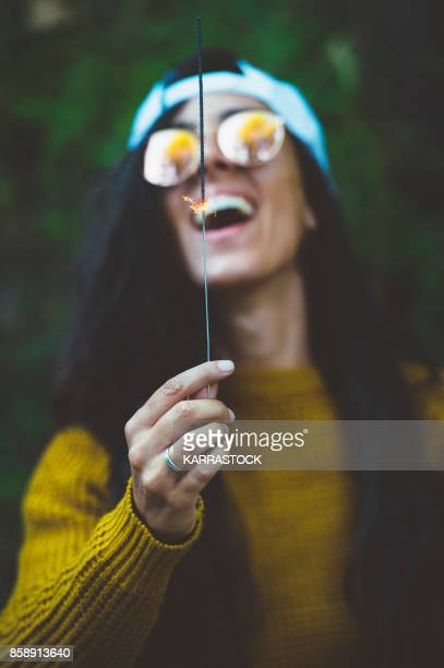 Woman and burning sparkler on nature