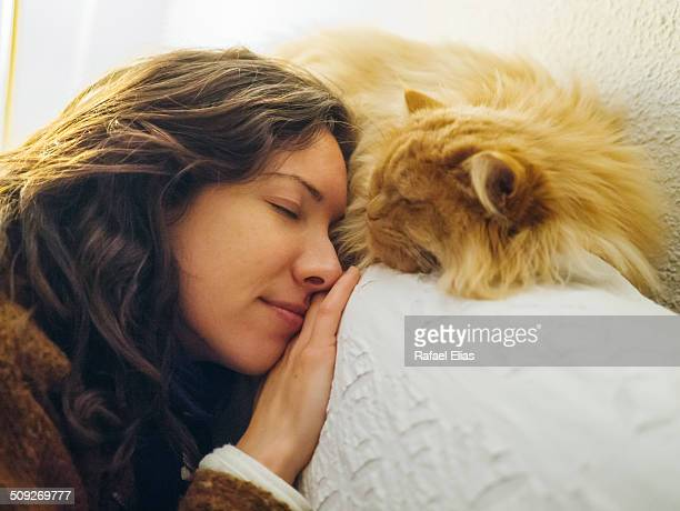 Woman and cat sleeping