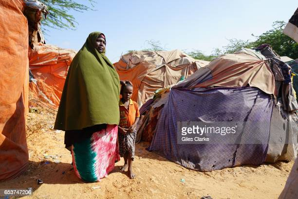 MOGADISHU SOMALIA MARCH 6 2017 A woman and child at an Internally Displaced Persons camp in Mogadishu According to an United Nations February 2017...