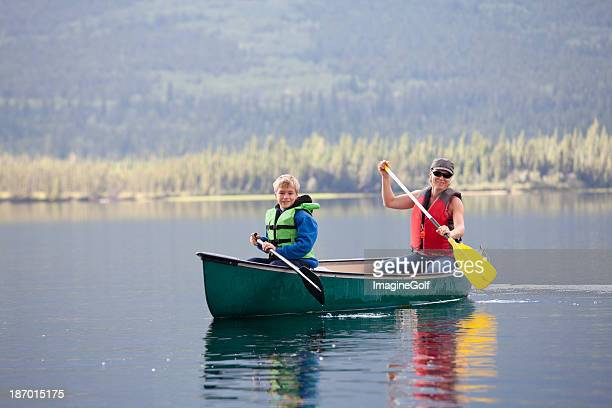 Woman and Child Canoeing on Mountain Lake