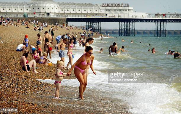 A woman and child enjoy the water and sunshine on Brighton beach July 30 2004 in Brighton England The United Kingdom is set for soaring temperatures...